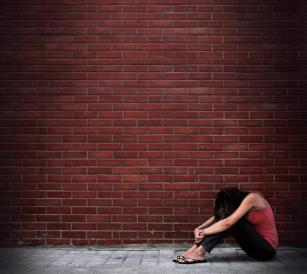 Brick Wall with Woman on Ground
