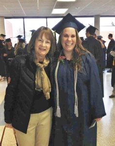 Charlotte at her college graduation with her mentor, Sheila!